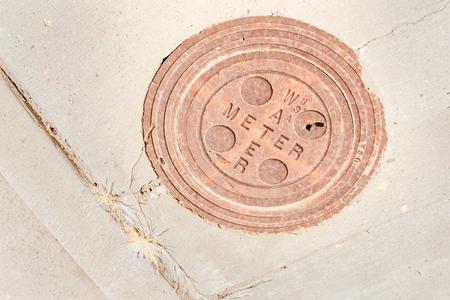 circular water meter cover in pavement