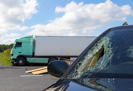 photo of truck in an accident with car