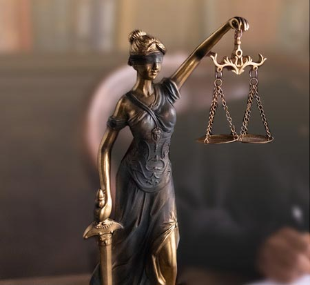 Statue of Lady Justice. A blind figure holding scales. Based on photo by EKATERINA BOLOVTSOVA from Pexels.com.