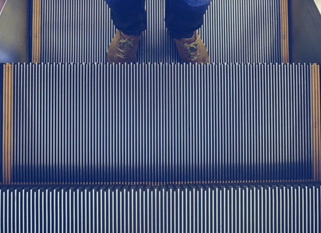 Person standing on an escalator